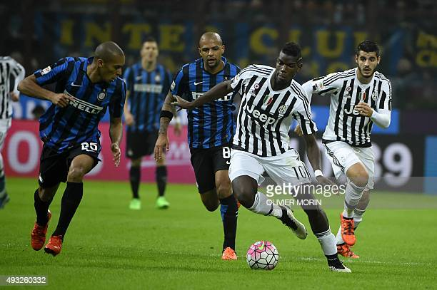 Juventus' midfielder from France Paul Pogba fights for the ball with Inter Milan's defender from Brazil Joao Miranda during the Italian Serie A...