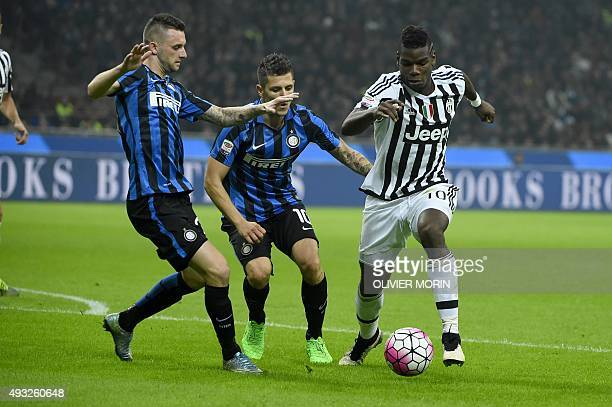 Juventus' midfielder from France Paul Pogba fights for the ball with Inter Milan's midfielder from Croatia Marcelo Brozovic during the Italian Serie...