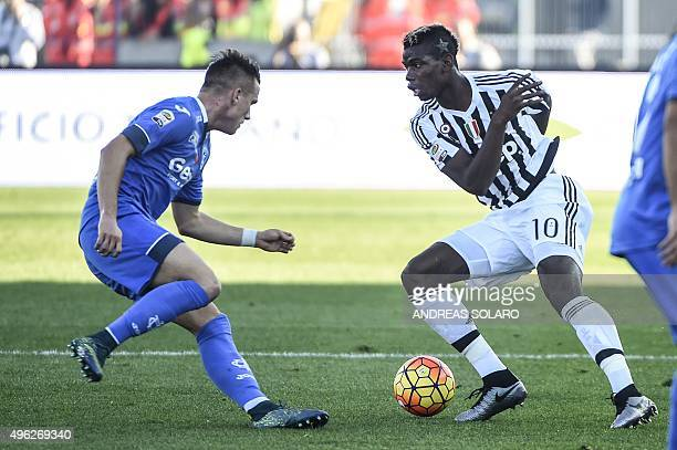 Juventus' midfielder from France Paul Pogba fights for the ball with Empoli's midfielder from Poland Piotr Zielinski during the Italian Serie A...