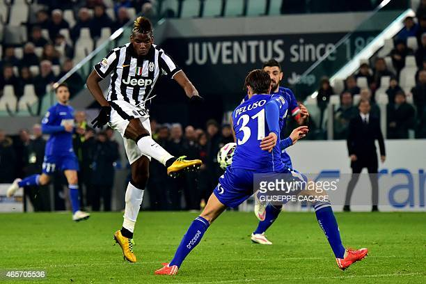 Juventus' midfielder from France Paul Pogba kicks and scores a goal during their Serie A football match Juventus vs Sassuolo at 'Juventus Stadium' in...
