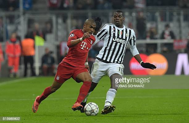 Juventus' midfielder from France Paul Pogba vies for the ball Bayern Munich's Brazilian midfielder Douglas Costa during the UEFA Champions League...