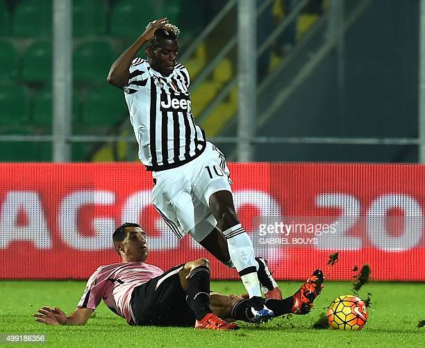 Juventus' midfielder from France Paul Pogba vies with Palermo's midfielder from Croatia Mato Jajalo during the Italian Serie A football match between...