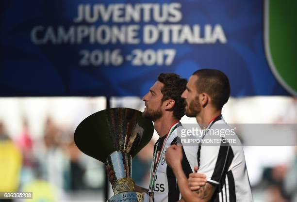 Juventus' midfielder from Italy Claudio Marchisio and Juventus' defender from Italy Leonardo Bonucci celebrate after winning the Italian Serie A...