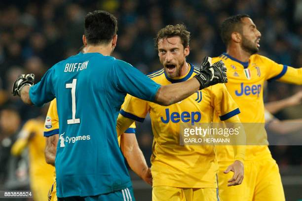 Juventus' midfielder from Italy Claudio Marchisio and Juventus' goalkeeper from Italy Gianluigi Buffon celebrate at the end of the Italian Serie A...