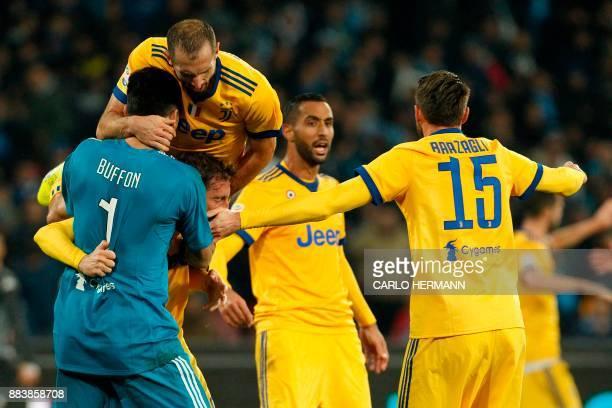 Juventus' midfielder from Italy Claudio Marchisio Juventus' goalkeeper from Italy Gianluigi Buffon and Juventus' defender from Italy Giorgio...