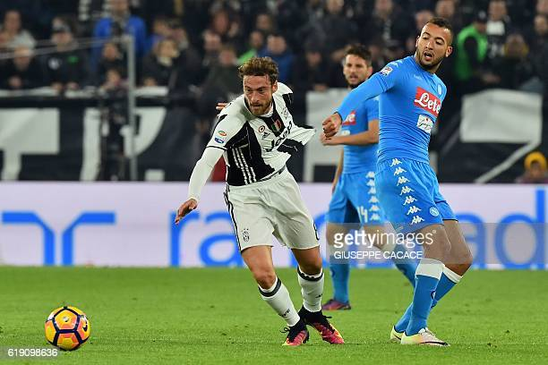 Juventus' midfielder from Italy Claudio Marchisio vies with Napoli's midfielder from Morocco Omar El Kaddouri during the Italian Serie A football...