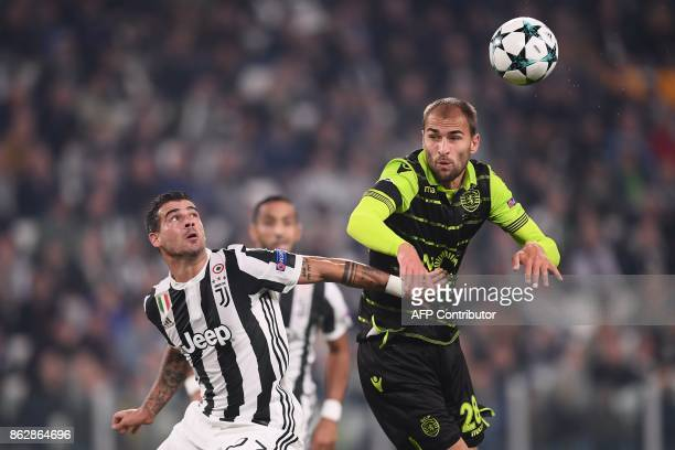 Juventus' midfielder from Italy Stefano Sturaro fights for the ball with Sporting's Dutch forward Bas Dost during the UEFA Champions League Group D...