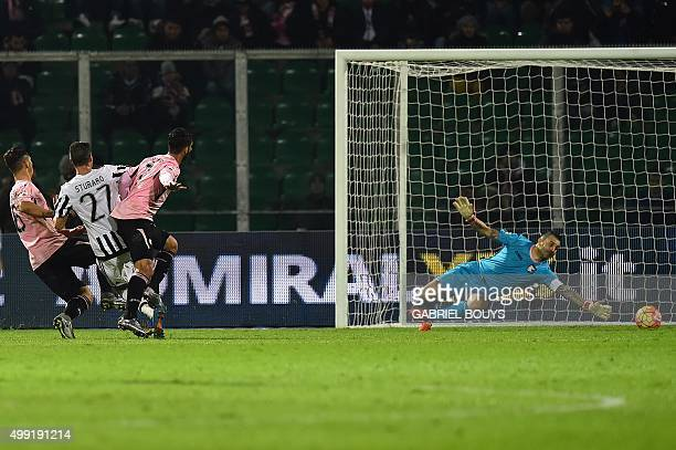 Juventus' midfielder from Italy Stefano Sturaro scores a goal in front of Palermo's goalkeeper from Italy Stefano Sorrentino during the Italian Serie...