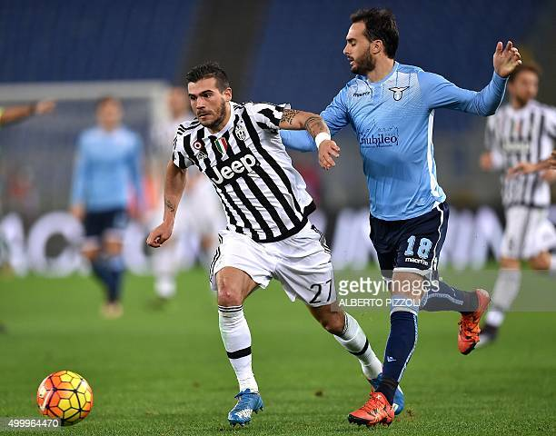 Juventus' midfielder from Italy Stefano Sturaro vies for the ball with Lazio's defender from Argentina Santiago Gentiletti during the Italian Serie A...