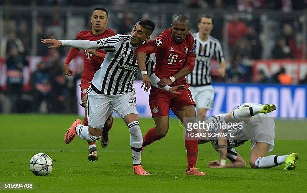 Juventus' midfielder from Italy Stefano Sturaro vies for the ball with Bayern Munich's Brazilian midfielder Douglas Costa during the UEFA Champions...