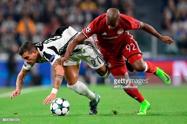 Juventus' midfielder from Italy Stefano Sturaro vies with Olympiacos' Brazilian forward Seba during the UEFA Champion's League Group D football match...