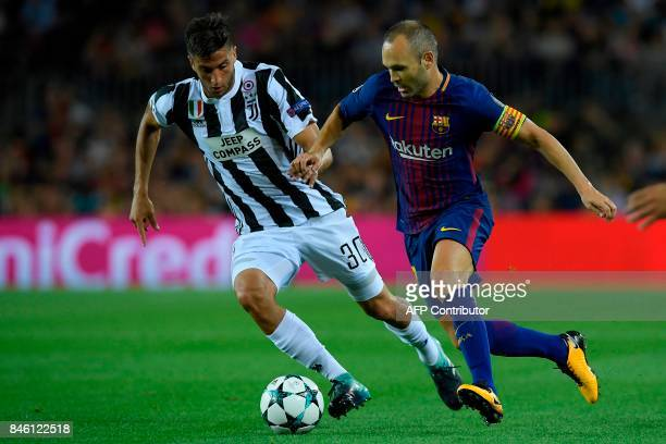 Juventus' midfielder from Uruguay Rodrigo Betancur vies with Barcelona's midfielder from Spain Andres Iniesta during the UEFA Champions League Group...