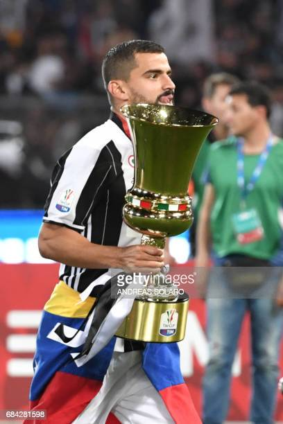 Juventus midfielder from Venezuela Tomas Rincon holds the trophy after winning the Italian Tim Cup final on May 17 2017 at the Olympic stadium in...