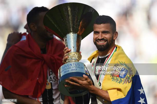 Juventus midfielder from Venezuela Tomas Rincon holds the trophy after winning the Italian Serie A football match Juventus vs Crotone and the...
