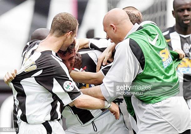 Juventus midfielder Gianluca Pessotto defender Ciro Ferrara Alessandro del Piero and goalkeeper Antonio Chimenti celebrate their victory against...