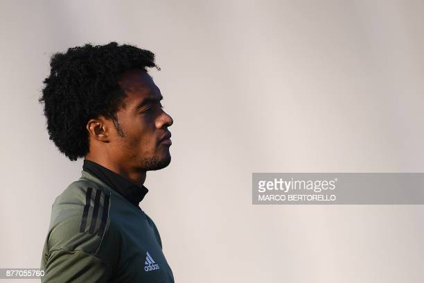 Juventus' midfielder Juan Cuadrado from Colombia attends a training session on the eve of the UEFA Champions League football match Juventus Vs...