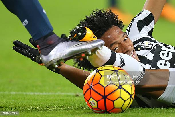 Juventus' midfielder Juan Cuadrado from Colombia fights for the ball with Genoa's forward Leonardo Pavoletti during the Italian Serie A football...