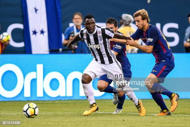 Juventus midfielder Kwadwo Asamoah defended against Barcelona midfielder Carles Alena during the International Champions Cup between Barcelona and...