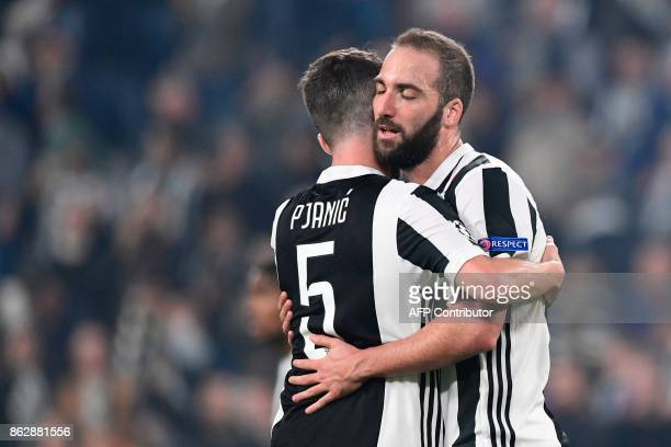 Juventus midfielder Miralem Pjanic and Juventus' forward from Argentina Gonzalo Higuain celebrate at the end of the UEFA Champions League Group D...