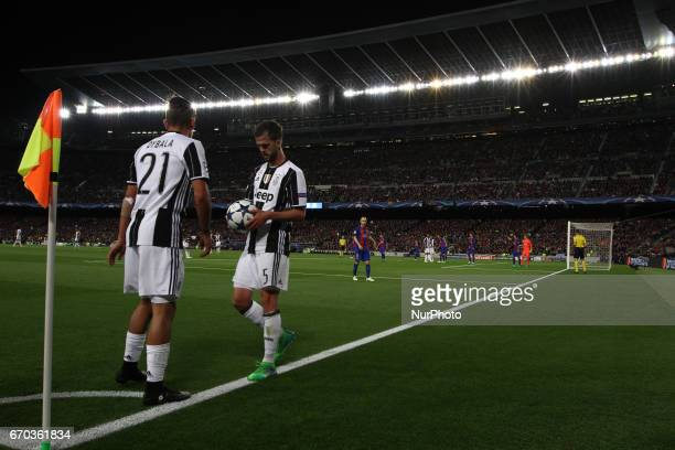 Juventus midfielder Miralem Pjanic and Juventus forward Paulo Dybala prepare to shoot corner kick during the Uefa Champions League quarter finals...