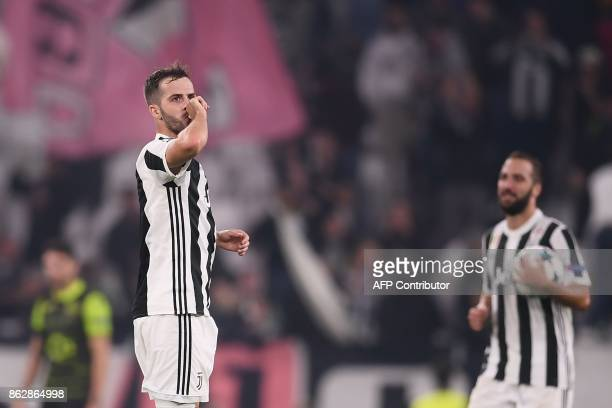 Juventus midfielder Miralem Pjanic celebrates after scoring during the UEFA Champions League Group D football match Juventus vs Sporting CP at the...