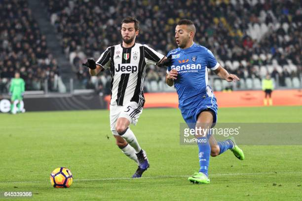 Juventus midfielder Miralem Pjanic fights for the ball against Empoli midfielder Omar El Kaddouri during the Serie A football match n26 JUVENTUS...