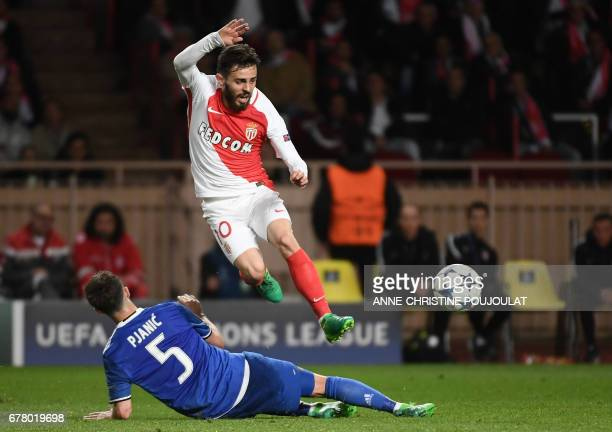 Juventus midfielder Miralem Pjanic fights for the ball with Monaco's Portuguese midfielder Bernardo Silva during the UEFA Champions League semifinal...