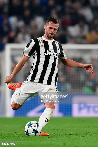 Juventus midfielder Miralem Pjanic kicks the ball during the UEFA Champions League Group D football match Juventus vs Sporting CP at the Juventus...