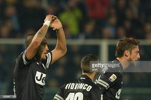 Juventus' midfielder of Chile Arturo Vidal celebrates after scoring during the Italian Serie A football match between Pescara and Juventus on...