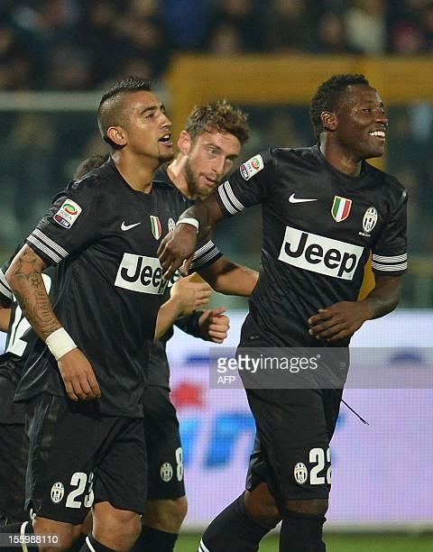 Juventus' midfielder of Chile Arturo Vidal celebrates after scoring with team mates midfielder of Ghana Kwadwo Asamoah and midfielder Claudio...