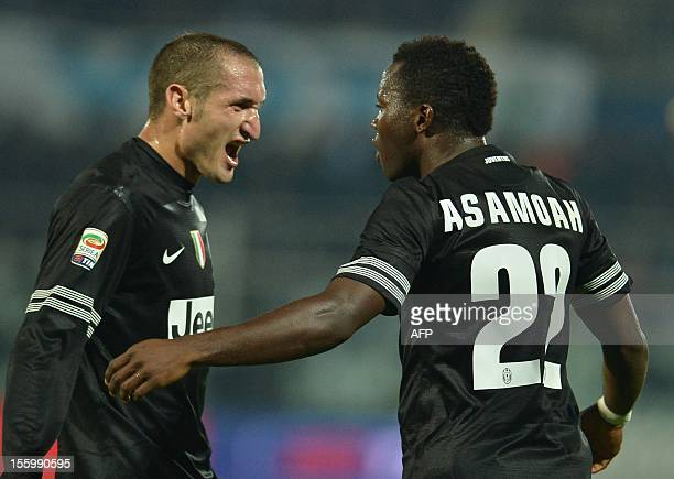 Juventus' midfielder of Ghana Kwadwo Asamoah celebrates scoring with defender Giorgio Chiellini during the Italian Serie A football match between...