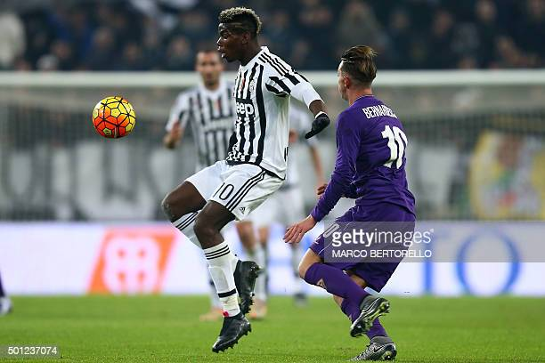 Juventus' midfielder Paul Pogba from France fights for the ball with Fiorentina's forward Federico Bernardeschi during the Italian Serie A football...