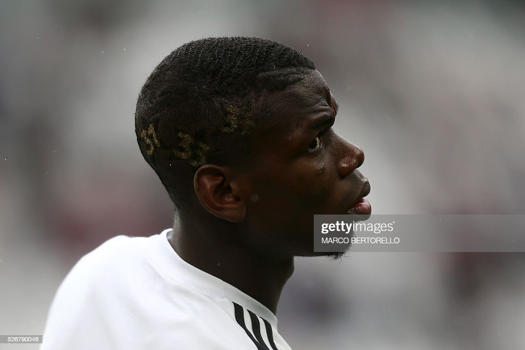 Juventus' midfielder Paul Pogba from France has a new haircut with the numbers of the 'Scudetto' won by his team during the Italian Serie A football match Juventus Vs Carpi on May 1, 2016 at the 'Juventus Stadium' in Turin. / AFP / MARCO