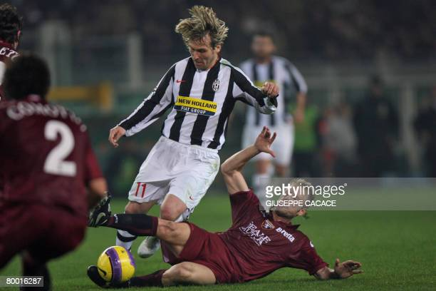 Juventus' midfielder Pavel Nedved is tackled by Torino's midfielder Vincenzo Grella during their 'Serie A' football match on February 26 2008 at...