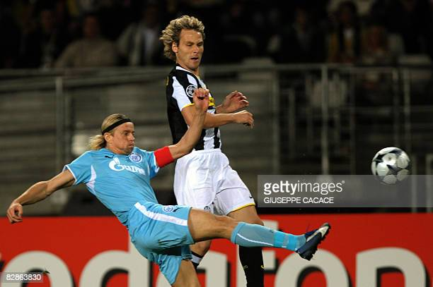 Juventus' midfielder Pavel Nedved of Czech Republic fights for the ball with Zenit's midfielder Anatoliy Tymoschuk of Ukraine during their Champions...