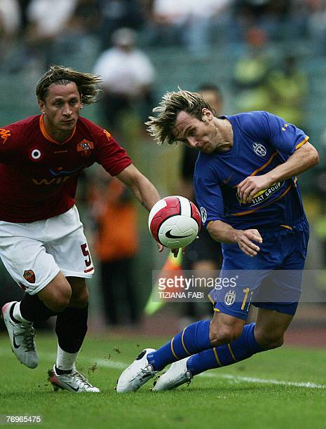 Juventus' midfielder Pavel Nedved vies for the ball with AS Roma's defender Philippe Mexes during their Italian Serie A football match at Olympic...