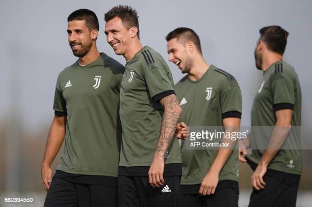 Juventus' midfielder Sami Khedira from Germany and Juventus' forward Mario Mandzukic from Croatia attend a training session on the eve of the UEFA...