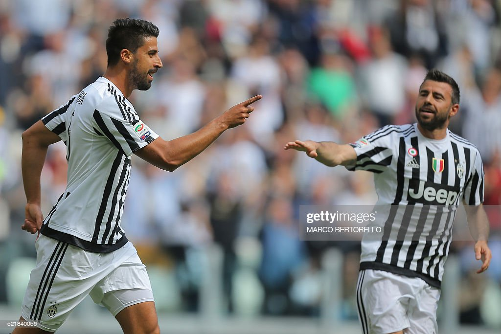 Juventus' midfielder Sami Khedira from Germany celebrates after scoring with his teammate Juventus' defender Andrea Barzagli during the Italian Serie...