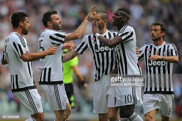 Juventus' midfielder Sami Khedira from Germany celebrates with teammates Juventus' defender from Italy Andrea Barzagli Juventus' midfielder from...