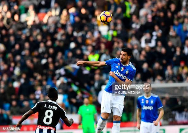 Juventus' midfielder Sami Khedira from Germany heads the ball during the Italian Serie A football match Udinese vs Juventus at the Dacia Arena...
