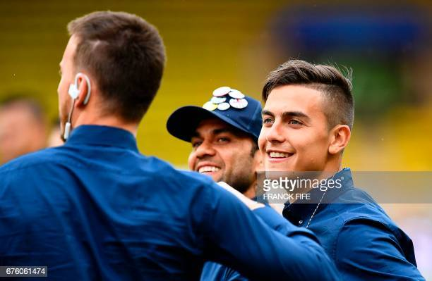 Juventus' midfielder Tomas Rincon jokes with Juventus' forward from Argentina Paulo Dybala at Louis II Stadium in Monaco on May 2 on the eve of their...