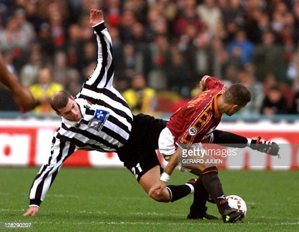Juventus midfielder Zinedine Zidane is stopped by AS Roma defender Luigi Di Biagio during their Serie A match in Rome 15 November Roma won 20