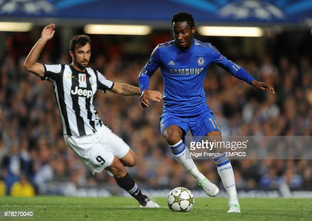 Juventus' Mirko Vucinic and Chelsea's Mikel battle for the ball