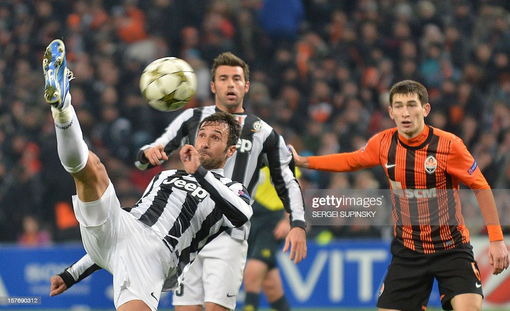 Juventus' Mirko Vucinic (L) kicks the ball during the UEFA Champions League, Group E, football match between FC Shakhtar and Juventus, in Donetsk on December 5, 2012.