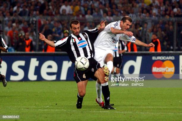 Juventus' Paolo Montero and Real Madrid's Zinedine Zidane battle for the ball