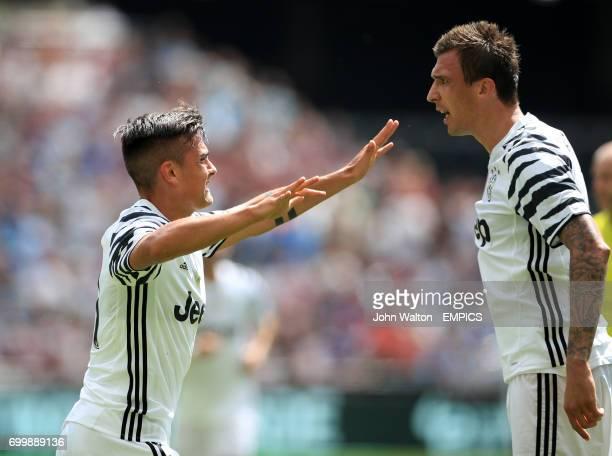 Juventus' Paulo Dybala celebrates scoring his side's first goal of the game