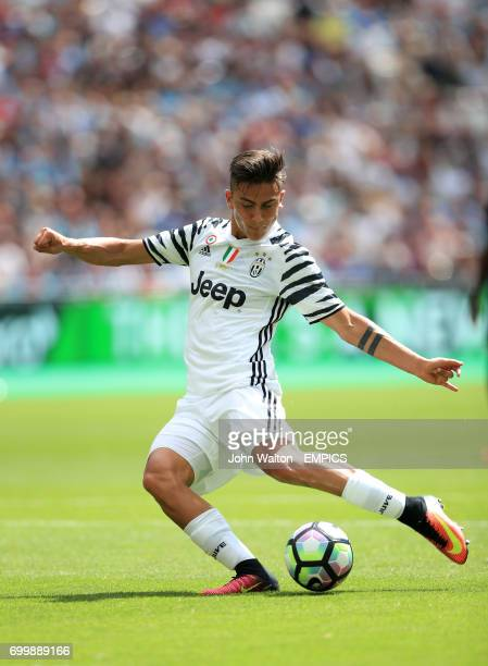 Juventus' Paulo Dybala scores his side's first goal of the game