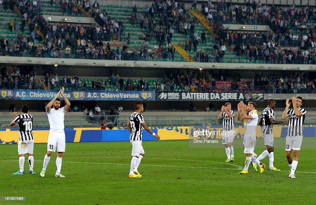 Juventus players applaud fans after the Serie A match between AC Chievo Verona and Juventus at Stadio Marc'Antonio Bentegodi on September 25, 2013 in Verona, Italy.