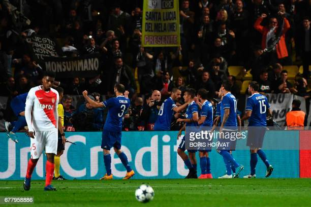 Juventus players celebrate a goal by forward from Argentina Gonzalo Higuain during the UEFA Champions League semifinal first leg football match...
