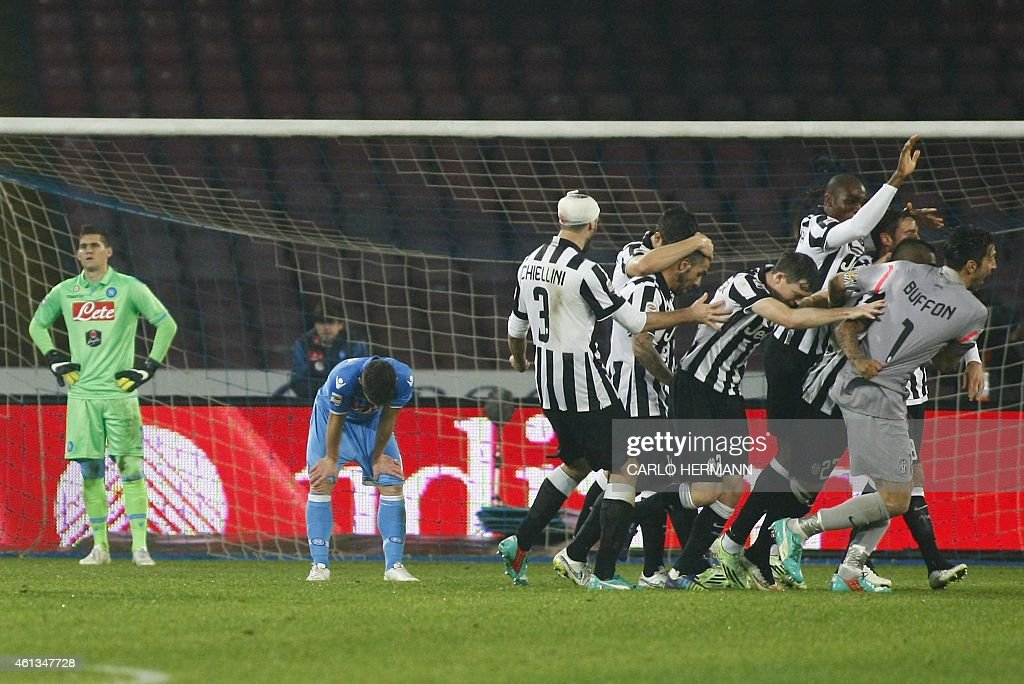 Juventus' players celebrate after scoring during the Italian Serie A football match SSC Napoli vs Juventus FC on January 11 2015 at the San Paolo...